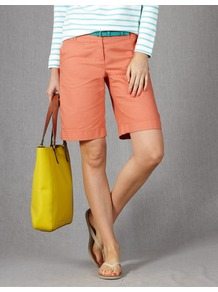 Off Duty Shorts - pattern: plain; style: shorts; pocket detail: small back pockets, pockets at the sides; waist detail: belted waist/tie at waist/drawstring; length: mid thigh shorts; waist: mid/regular rise; predominant colour: coral; occasions: casual, holiday; fibres: cotton - stretch; texture group: cotton feel fabrics; fit: straight leg; pattern type: fabric; pattern size: standard