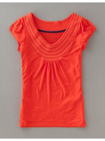 Stitch Detail Tee - neckline: v-neck; sleeve style: capped; style: t-shirt; bust detail: ruching/gathering/draping/layers/pintuck pleats at bust; predominant colour: bright orange; occasions: casual, work, holiday; length: standard; fibres: viscose/rayon - 100%; fit: straight cut; shoulder detail: added shoulder detail; sleeve length: short sleeve; pattern type: fabric; pattern: patterned/print; texture group: jersey - stretchy/drapey