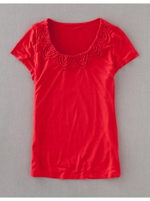 Capri Tee - sleeve style: capped; pattern: plain; bust detail: added detail/embellishment at bust; style: t-shirt; predominant colour: true red; occasions: casual, work; length: standard; neckline: scoop; fibres: viscose/rayon - stretch; fit: body skimming; sleeve length: sleeveless; pattern type: fabric; texture group: jersey - stretchy/drapey