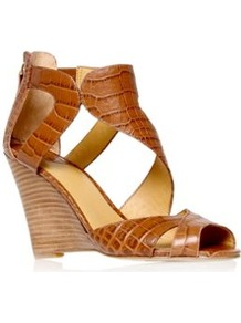 Missfitz - predominant colour: tan; occasions: casual, evening, holiday; material: leather; heel height: high; embellishment: zips; ankle detail: ankle strap; heel: wedge; toe: open toe/peeptoe; style: standard; finish: plain; pattern: animal print