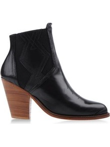 Boots Ankle Boots On Shoescribe.Com - predominant colour: black; occasions: casual, evening, work; material: leather; heel height: high; embellishment: elasticated; heel: block; toe: round toe; boot length: ankle boot; style: standard; trends: modern geometrics; finish: plain; pattern: plain