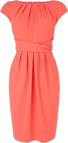 Dilys Tailored Pleat Dress Orange Carnelian - style: shift; neckline: round neck; sleeve style: capped; fit: tailored/fitted; pattern: plain; waist detail: twist front waist detail/nipped in at waist on one side/soft pleats/draping/ruching/gathering waist detail; predominant colour: coral; occasions: casual, evening, work, occasion; length: just above the knee; fibres: polyester/polyamide - mix; hip detail: structured pleats at hip; sleeve length: short sleeve; bust detail: tiers/frills/bulky drapes/pleats; pattern type: fabric; texture group: woven light midweight