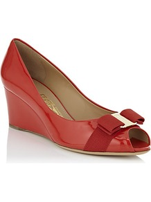 Sissi Patent Wedge Pump Red - predominant colour: true red; occasions: evening, work, occasion; material: leather; heel height: mid; heel: wedge; toe: open toe/peeptoe; style: courts; finish: patent; pattern: plain; embellishment: bow