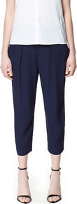 Pleated Ankle Length Trousers - pattern: plain; style: peg leg; waist: mid/regular rise; predominant colour: navy; occasions: evening, work; length: calf length; fibres: polyester/polyamide - 100%; hip detail: front pleats at hip level; texture group: crepes; fit: tapered; pattern type: fabric; pattern size: standard