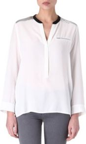 Eldorado Silk Blouse - pattern: plain; bust detail: pocket detail at bust; style: blouse; predominant colour: ivory; occasions: casual, evening, work; length: standard; neckline: mandarin with v-neck; fibres: silk - 100%; fit: body skimming; shoulder detail: added shoulder detail; back detail: longer hem at back than at front; sleeve length: long sleeve; sleeve style: standard; texture group: silky - light; pattern type: fabric