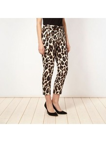 Designer Cream Animal Printed Trousers - waist: mid/regular rise; predominant colour: chocolate brown; occasions: casual, evening, holiday; length: ankle length; fibres: cotton - stretch; waist detail: narrow waistband; trends: statement prints; fit: skinny/tight leg; pattern type: fabric; pattern size: small &amp; busy; pattern: animal print; texture group: jersey - stretchy/drapey; style: standard
