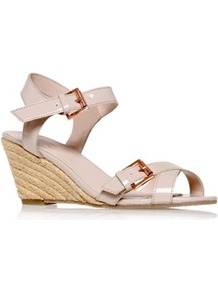 Malcolm - predominant colour: nude; occasions: casual, holiday; material: faux leather; heel height: mid; embellishment: buckles; ankle detail: ankle strap; heel: wedge; toe: open toe/peeptoe; style: standard; finish: patent; pattern: plain