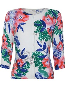 Lola Printed Cardigan - neckline: round neck; predominant colour: white; occasions: casual, evening, work; length: standard; style: standard; fibres: cotton - 100%; fit: slim fit; sleeve length: 3/4 length; sleeve style: standard; texture group: knits/crochet; trends: high impact florals; pattern type: knitted - other; pattern size: big &amp; busy; pattern: florals