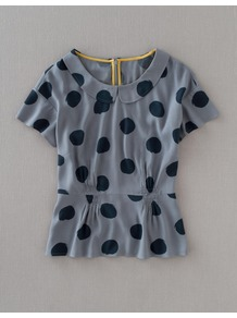Sophia Top - pattern: polka dot; waist detail: peplum waist detail; predominant colour: mid grey; occasions: casual, evening, work; length: standard; style: top; fibres: polyester/polyamide - 100%; fit: tailored/fitted; neckline: no opening/shirt collar/peter pan; sleeve length: short sleeve; sleeve style: standard; trends: statement prints; pattern type: fabric; pattern size: small &amp; busy; texture group: jersey - stretchy/drapey