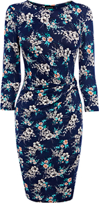 Floral Pattern Wrap Dress - style: faux wrap/wrap; neckline: round neck; waist detail: twist front waist detail/nipped in at waist on one side/soft pleats/draping/ruching/gathering waist detail; predominant colour: navy; occasions: casual, evening, work; length: just above the knee; fit: body skimming; fibres: polyester/polyamide - stretch; hip detail: ruching/gathering at hip; sleeve length: 3/4 length; sleeve style: standard; trends: high impact florals; pattern type: fabric; pattern size: small & busy; pattern: florals; texture group: jersey - stretchy/drapey