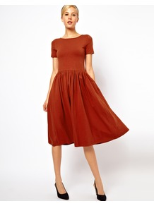 Midi Dress With Short Sleeves - length: below the knee; neckline: round neck; pattern: plain; waist detail: twist front waist detail/nipped in at waist on one side/soft pleats/draping/ruching/gathering waist detail; predominant colour: terracotta; occasions: casual, evening, work; fit: fitted at waist & bust; style: fit & flare; fibres: cotton - stretch; hip detail: soft pleats at hip/draping at hip/flared at hip; sleeve length: short sleeve; sleeve style: standard; pattern type: fabric; texture group: jersey - stretchy/drapey