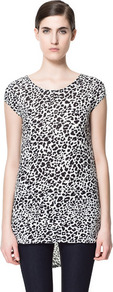 T Shirt With Asymmetric Hem - neckline: round neck; sleeve style: capped; length: below the bottom; style: t-shirt; predominant colour: black; occasions: casual, evening, work; fibres: polyester/polyamide - 100%; fit: body skimming; back detail: longer hem at back than at front; sleeve length: short sleeve; pattern type: fabric; pattern size: small &amp; busy; pattern: animal print, patterned/print; texture group: jersey - stretchy/drapey