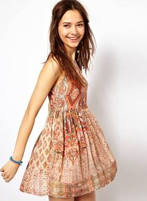 Tribal Print Dress - length: mid thigh; neckline: round neck; sleeve style: sleeveless; waist detail: twist front waist detail/nipped in at waist on one side/soft pleats/draping/ruching/gathering waist detail; occasions: casual, evening, holiday; fit: fitted at waist & bust; style: fit & flare; fibres: viscose/rayon - 100%; hip detail: sculpting darts/pleats/seams at hip; predominant colour: multicoloured; sleeve length: sleeveless; pattern type: fabric; pattern size: big & busy; pattern: patterned/print; texture group: other - light to midweight