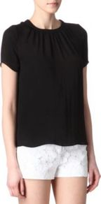 Estime Keyhole Back Top - pattern: plain; neckline: high neck; back detail: low cut/open back; bust detail: ruching/gathering/draping/layers/pintuck pleats at bust; predominant colour: black; occasions: evening, work, holiday; length: standard; style: top; fibres: polyester/polyamide - 100%; fit: straight cut; sleeve length: short sleeve; sleeve style: standard; texture group: crepes; pattern type: fabric; pattern size: standard; embellishment: beading