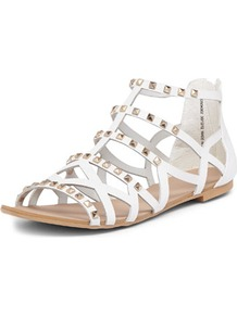 White Gladiator Sandals - predominant colour: white; occasions: casual, holiday; material: faux leather; heel height: flat; embellishment: studs; ankle detail: ankle strap; heel: standard; toe: open toe/peeptoe; style: gladiators; finish: plain; pattern: plain