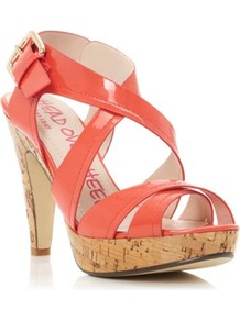 Coral Synthetic Patent Florence Cross Over Strap Heeled Sandal - predominant colour: coral; occasions: evening, holiday; material: faux leather; heel height: high; ankle detail: ankle strap; heel: platform; toe: open toe/peeptoe; style: strappy; finish: patent; pattern: plain