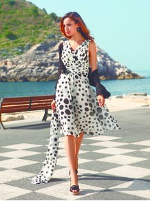 Ivory/Black Spot Ruched Dress - style: a-line; neckline: v-neck; fit: fitted at waist; sleeve style: sleeveless; waist detail: fitted waist; pattern: polka dot; predominant colour: white; occasions: evening, occasion; length: on the knee; fibres: polyester/polyamide - 100%; sleeve length: sleeveless; texture group: sheer fabrics/chiffon/organza etc.; pattern type: fabric; pattern size: small & busy