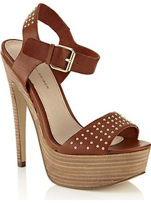 Martini Platform Sandal Chocolate - predominant colour: tan; occasions: evening, holiday; material: leather; heel height: high; embellishment: studs; ankle detail: ankle strap; heel: platform; toe: open toe/peeptoe; style: standard; finish: patent; pattern: plain