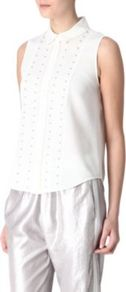 Calice Sleeveless Blouse - neckline: shirt collar/peter pan/zip with opening; sleeve style: sleeveless; style: blouse; back detail: contrast pattern/fabric at back; predominant colour: white; occasions: casual, evening, work; length: standard; fibres: polyester/polyamide - mix; fit: straight cut; bust detail: contrast pattern/fabric/detail at bust; sleeve length: sleeveless; texture group: lace; pattern type: fabric; pattern size: small & light; pattern: patterned/print; embellishment: beading