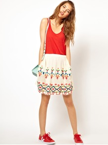 Embroidered Skirt - style: full/prom skirt; fit: loose/voluminous; waist detail: elasticated waist; waist: mid/regular rise; predominant colour: white; occasions: casual, holiday; length: just above the knee; fibres: cotton - 100%; hip detail: contrast fabric/print detail at hip; texture group: lace; pattern type: fabric; pattern size: standard; pattern: patterned/print; embellishment: embroidered