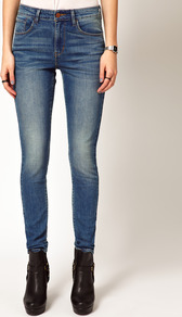 Distressed High Rise Skinny Jeans - style: skinny leg; length: standard; pattern: plain; waist: high rise; pocket detail: traditional 5 pocket; predominant colour: denim; occasions: casual; fibres: cotton - stretch; jeans detail: shading down centre of thigh; texture group: denim; pattern type: fabric