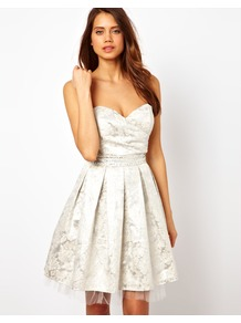 Metallic Prom Dress - neckline: strapless (straight/sweetheart); pattern: plain; style: prom dress; sleeve style: strapless; waist detail: fitted waist; predominant colour: silver; occasions: evening, occasion; length: just above the knee; fit: fitted at waist & bust; fibres: polyester/polyamide - 100%; hip detail: structured pleats at hip; sleeve length: sleeveless; texture group: structured shiny - satin/tafetta/silk etc.; pattern type: fabric; pattern size: small & light