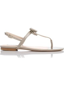 Bondi Patent Leather Brogued Bow Detail Flat Sandal Grey Clay - predominant colour: stone; occasions: casual, evening, holiday; material: leather; heel height: flat; ankle detail: ankle strap; heel: standard; toe: toe thongs; style: flip flops / toe post; finish: patent; pattern: plain; embellishment: bow