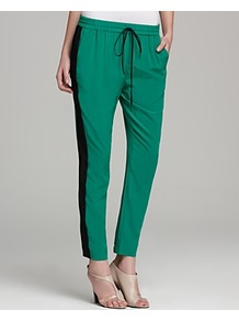 Pants Track - pattern: vertical stripes; style: tracksuit pants; pocket detail: pockets at the sides; waist detail: belted waist/tie at waist/drawstring; waist: mid/regular rise; predominant colour: emerald green; occasions: casual, evening, occasion; length: ankle length; fibres: silk - 100%; hip detail: fitted at hip (bottoms); texture group: silky - light; trends: sporty redux; fit: tapered; pattern type: fabric; pattern size: standard