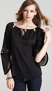 Etta Bead Sleeve Tunic - neckline: slash/boat neckline; pattern: plain; style: tunic; predominant colour: black; occasions: casual; length: standard; fit: body skimming; sleeve length: 3/4 length; sleeve style: standard; texture group: silky - light; pattern type: fabric; fibres: silk - stretch