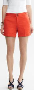 Heritage Buckle Tab Short - pattern: plain; style: shorts; pocket detail: small back pockets; length: short shorts; waist: mid/regular rise; predominant colour: bright orange; occasions: casual, holiday; fibres: cotton - stretch; jeans & bottoms detail: turn ups; texture group: cotton feel fabrics; fit: slim leg; pattern type: fabric