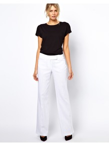 Linen Trousers In Wide Leg - pattern: plain; length: extra long; waist: mid/regular rise; predominant colour: white; occasions: casual, evening, occasion, holiday; fibres: linen - mix; texture group: linen; fit: wide leg; pattern type: fabric; style: standard