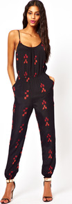 Jumpsuit In Aztec Print - sleeve style: spaghetti straps; fit: fitted at waist; hip detail: side pockets at hip; waist detail: twist front waist detail/nipped in at waist on one side/soft pleats/draping/ruching/gathering waist detail; secondary colour: true red; predominant colour: black; occasions: casual, evening, holiday; length: ankle length; neckline: scoop; fibres: viscose/rayon - 100%; sleeve length: sleeveless; style: jumpsuit; pattern type: fabric; pattern size: small & light; pattern: patterned/print; texture group: other - light to midweight