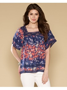 Millie Print Top - sleeve style: dolman/batwing; predominant colour: navy; secondary colour: coral; occasions: casual, holiday; length: standard; style: top; fibres: cotton - 100%; fit: loose; bust detail: contrast pattern/fabric/detail at bust; sleeve length: short sleeve; texture group: cotton feel fabrics; neckline: low square neck; pattern type: fabric; pattern size: small &amp; busy; pattern: florals; embellishment: lace