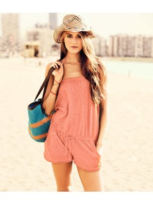 Jumpsuit - fit: loose; pattern: plain; neckline: halter neck; length: short shorts; predominant colour: coral; fibres: cotton - mix; sleeve length: sleeveless; occasions: holiday; style: playsuit; pattern type: fabric; texture group: jersey - stretchy/drapey