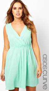 Curve Exclusive Skater Dress In Cheesecloth - style: faux wrap/wrap; neckline: low v-neck; fit: fitted at waist; pattern: plain; sleeve style: sleeveless; waist detail: twist front waist detail/nipped in at waist on one side/soft pleats/draping/ruching/gathering waist detail; predominant colour: pistachio; occasions: casual, holiday; length: just above the knee; fibres: cotton - 100%; hip detail: soft pleats at hip/draping at hip/flared at hip; sleeve length: sleeveless; texture group: cotton feel fabrics; pattern type: fabric