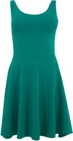Jade Sleeveless Skater Dress - length: mid thigh; neckline: round neck; pattern: plain; sleeve style: sleeveless; waist detail: fitted waist; back detail: low cut/open back; predominant colour: emerald green; occasions: casual; fit: fitted at waist &amp; bust; style: fit &amp; flare; fibres: cotton - stretch; hip detail: soft pleats at hip/draping at hip/flared at hip; sleeve length: sleeveless; pattern type: fabric; texture group: jersey - stretchy/drapey