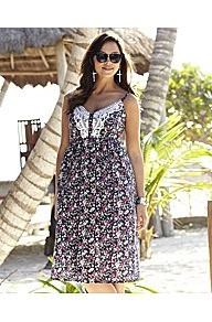 Print Dress - length: below the knee; neckline: low v-neck; sleeve style: spaghetti straps; fit: empire; style: sundress; occasions: casual, holiday; fibres: cotton - 100%; bust detail: contrast pattern/fabric/detail at bust; predominant colour: multicoloured; sleeve length: sleeveless; texture group: cotton feel fabrics; trends: high impact florals; pattern type: fabric; pattern size: small &amp; busy; pattern: florals