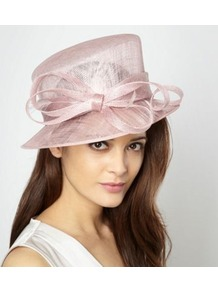 Rose Pink Spiralled Bow Hat - predominant colour: blush; occasions: evening, occasion; type of pattern: standard; style: brimmed; size: large; material: macrame/raffia/straw; embellishment: bow; pattern: plain