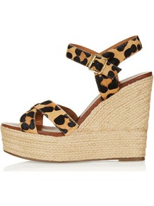 Whispered Cross Over Wedges - secondary colour: camel; predominant colour: black; occasions: casual, evening, holiday; material: leather; ankle detail: ankle strap; heel: wedge; toe: open toe/peeptoe; style: strappy; finish: plain; pattern: animal print; heel height: very high