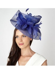Designer Blue Twist Feather Head Piece - predominant colour: royal blue; occasions: evening, occasion; type of pattern: small; style: fascinator; size: large; material: macrame/raffia/straw; embellishment: feather; pattern: plain