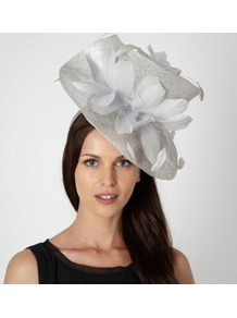 Designer Silver Twist Feather Hair Piece - predominant colour: silver; occasions: occasion; type of pattern: heavy; style: wide brimmed; size: large; material: sinamay; embellishment: feather; pattern: plain