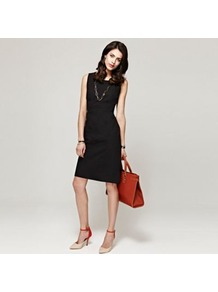 Black Shift Dress In Clever Fabric - style: shift; neckline: round neck; pattern: plain; sleeve style: sleeveless; waist detail: fitted waist; predominant colour: black; occasions: evening, work, occasion; length: just above the knee; fit: body skimming; fibres: cotton - 100%; sleeve length: sleeveless; pattern type: fabric; texture group: jersey - stretchy/drapey