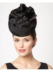 Black Ruffled Floral Fascinator - predominant colour: black; occasions: evening, occasion; type of pattern: light; style: fascinator; size: large; material: macrame/raffia/straw; pattern: plain; embellishment: corsage