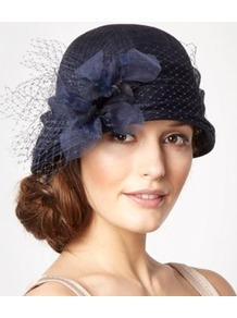 Designer Navy Dahlia Cloche Hat - predominant colour: navy; occasions: evening, occasion; type of pattern: light; style: cloche; size: standard; material: sinamay; pattern: plain; embellishment: corsage