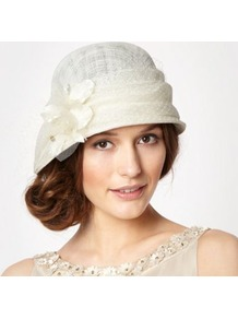 Designer Cream Dahlia Cloche Hat - predominant colour: ivory; occasions: evening, occasion, holiday; type of pattern: light; style: cloche; size: standard; material: sinamay; pattern: florals; embellishment: corsage