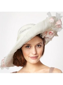 Designer Cream Climbing Roses Saucer Fascinator - predominant colour: white; secondary colour: blush; occasions: evening, occasion; type of pattern: large; style: wide brimmed; size: large; material: sinamay; pattern: plain; trends: high impact florals; embellishment: corsage