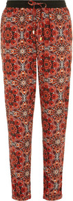 Orange Kaleidoscope Patterned Jogger - length: standard; style: tracksuit pants; pocket detail: pockets at the sides; waist detail: belted waist/tie at waist/drawstring; waist: mid/regular rise; predominant colour: coral; secondary colour: black; occasions: casual, evening, holiday; fibres: polyester/polyamide - 100%; hip detail: front pleats at hip level; texture group: crepes; trends: modern geometrics; fit: tapered; pattern type: fabric; pattern size: big &amp; busy; pattern: patterned/print
