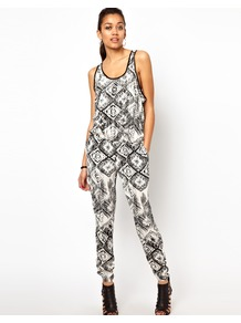 Tribal Print Jumpsuit - length: standard; sleeve style: sleeveless; hip detail: side pockets at hip; occasions: casual, evening, holiday; fit: body skimming; neckline: scoop; fibres: polyester/polyamide - 100%; sleeve length: sleeveless; predominant colour: monochrome; style: jumpsuit; pattern type: fabric; pattern size: big & busy; pattern: patterned/print; texture group: other - light to midweight