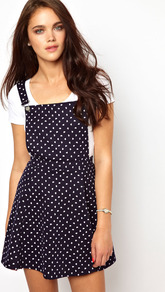 Pinny Bib Dress - length: mid thigh; sleeve style: standard vest straps/shoulder straps; fit: fitted at waist; style: dungaree dress; pattern: polka dot; secondary colour: white; predominant colour: navy; occasions: casual; fibres: cotton - stretch; hip detail: soft pleats at hip/draping at hip/flared at hip; back detail: crossover; sleeve length: sleeveless; neckline: low square neck; pattern type: fabric; pattern size: small & busy; texture group: jersey - stretchy/drapey