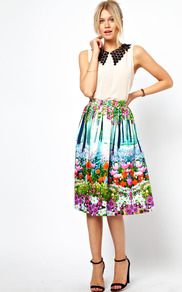 Midi Skirt In New Floral Print - length: below the knee; style: full/prom skirt; fit: loose/voluminous; waist detail: fitted waist; waist: mid/regular rise; predominant colour: pale blue; secondary colour: emerald green; occasions: casual, work; fibres: cotton - stretch; hip detail: soft pleats at hip/draping at hip/flared at hip; trends: high impact florals; pattern type: fabric; pattern size: small & busy; pattern: florals; texture group: jersey - stretchy/drapey